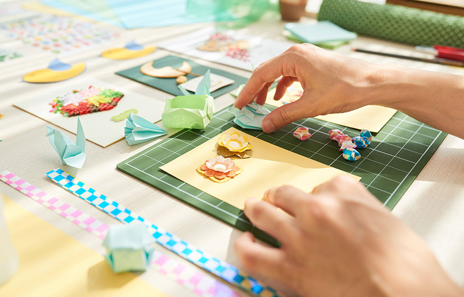 Woman making hand made greeting cards